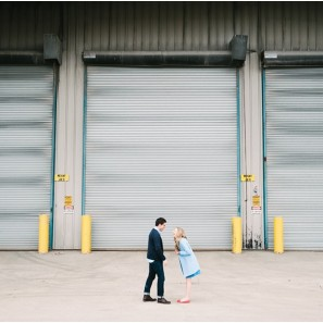Industrial garage doors with couple.